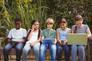 Children using technologies at park
